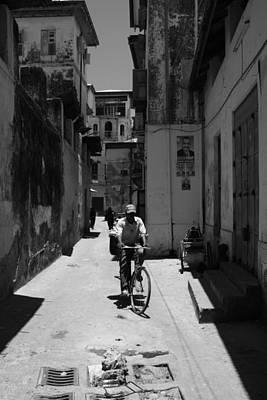 Photograph - Stone Town Cyclist by Aidan Moran