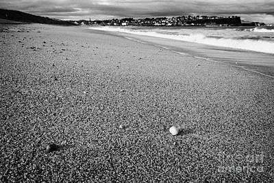 Stones And Pebbles On Ballycastle Beach In Winter County Antrim Northern Ireland Art Print by Joe Fox