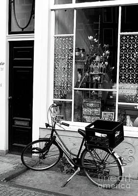 Photograph - Store Bike by John Rizzuto