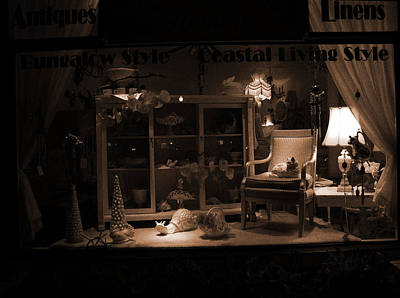 Store Window At Night Art Print by Phil Penne