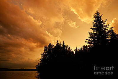Storm Clouds At Sunset Art Print by Larry Ricker
