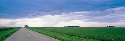 Vanishing America Photograph - Storm Clouds Over A Landscape by Panoramic Images
