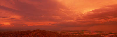 South Mountain Photograph - Storm Clouds Over Mountains At Sunset by Panoramic Images