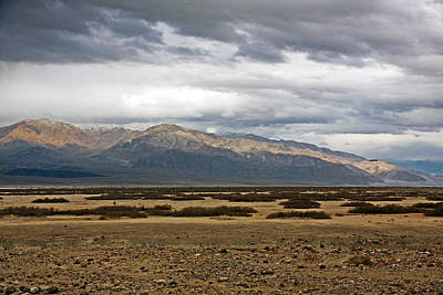 Alluvium Photograph - Storm Clouds Over Snowy Peaks by Stuart Litoff