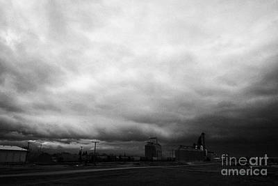 storm snow clouds forming over grain plant on the prairies assiniboia Saskatchewan Canada Art Print