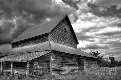 Stormy Clouds Over The Rustic Old Barn Art Print by Reid Callaway