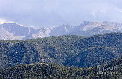 Steve Krull Royalty-Free and Rights-Managed Images - Stormy Pikes Peak by Steve Krull