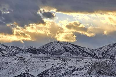 Stormy Sunset Over Snow Capped Mountains Art Print by Tracie Kaska