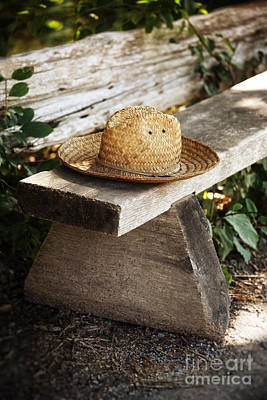 Photograph - Straw Hat On Wooden Bench by Sandra Cunningham