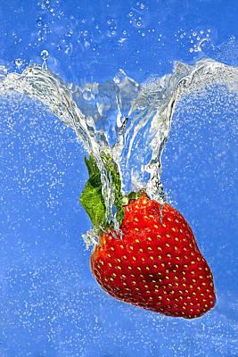 Strawberry Splashing Into Water Art Print by Judy Kennamer
