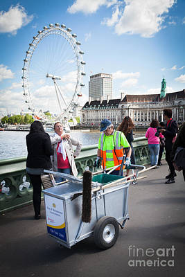 Street Cleaner With Cart Amongst Tourists With London Eye. Art Print