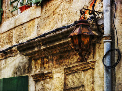Photograph - Street Lamp And Wall Texture Arles France Number Five by Bob Coates