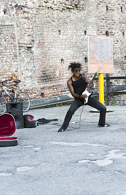 Musicians Royalty Free Images - Street Musician Milan Italy Royalty-Free Image by Sally Rockefeller