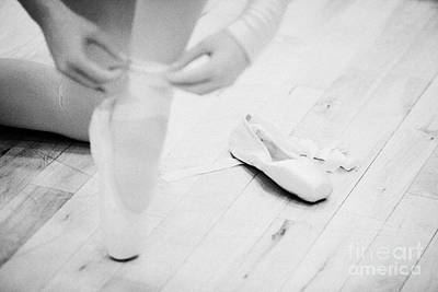 Student Putting On Pointe Shoes At A Ballet School In The Uk Print by Joe Fox