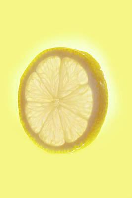 Yellow Photograph - Studio Shot Of A Lemon On Yellow by Michael Duva