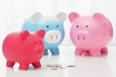 Piggy Bank Wall Art - Photograph - Studio Shot Of Piggy Banks by Vstock Llc