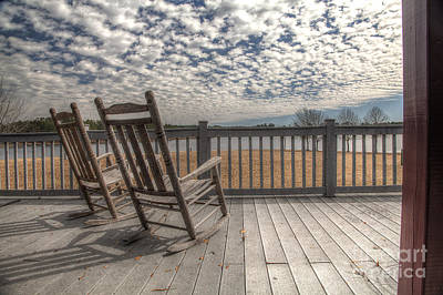 Rocking Chairs Photograph - Studying The Clouds  by Larry Braun