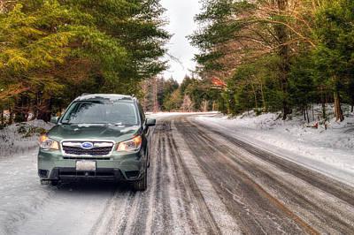 Blue Subaru Photograph - Subaru Forester On A Winter Road by Geoffrey Coelho