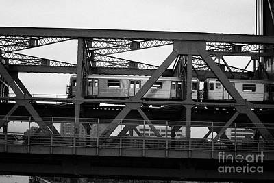 subway train crossing the Broadway Bridge from Manhattan to the Bronx new york city Art Print by Joe Fox
