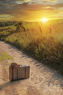 Photograph - Suitcase With Hat On Road At Sunset by Sandra Cunningham