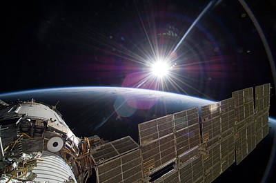 Curvature Photograph - Sun And The Iss by Nasa