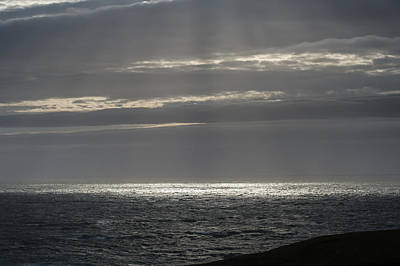 Photograph - Sunlight At Sea Past Stoer Lighthouse by Gary Eason