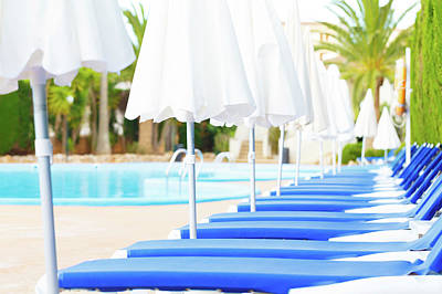 Poolside Photograph - Sunloungers And Parasols In A Row by Wladimir Bulgar