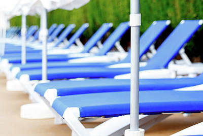 Poolside Photograph - Sunloungers In A Row by Wladimir Bulgar
