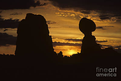 Photograph - Sunrise Arches National Park With Balanced Rock Silhouetted Agai by Jim Corwin