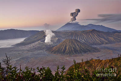 sunrise at vulcano Bromo with sea of sand vulcano Semeru with eruption Java Indonesia Original