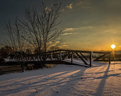 Western Snowfall Photograph - Sunrise Over A Snow Covered Bridge by Chris Bordeleau