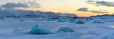 Cold Temperature Photograph - Sunrise Over Icebergs In Frozen Lagoon by Panoramic Images