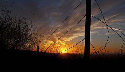 Photograph - Sunset Along The Fence Yellow Red Orange Fine Art Photography Print  by Jerry Cowart
