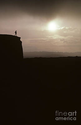 Photograph - Sunset Arches National Park With Silhouetted Man On Ridge With S by Jim Corwin