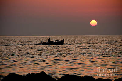 Colorful People Abstract Royalty Free Images - Sunset boat at sea Royalty-Free Image by Raimond Klavins