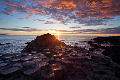Water Photograph - Sunset Over The Giants Causeway by Gareth Mccormack