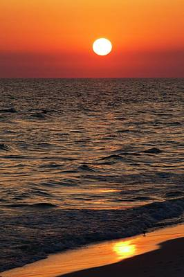 Sunset Over The Ocean And A Beach Art Print by Jim Edds