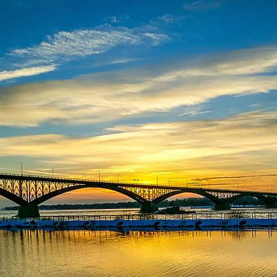 Bridge Pilings Photograph - Sunset Over The Peace Bridge by Chris Bordeleau