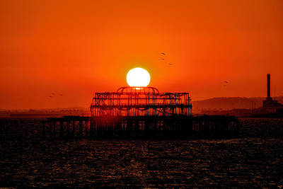 Sunset Over The Remains Of The West Pier Art Print by Chris Lord