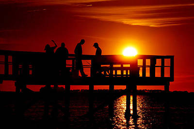 Photograph - Sunset Silhouettes At Crystal Beach Pier by Daniel Woodrum