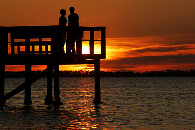 Photograph - Sunset Silhouettes At Crystal Beach Pier II by Daniel Woodrum