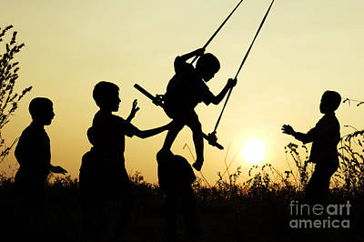 Child Swinging Photograph - Sunset Swing by Tim Gainey