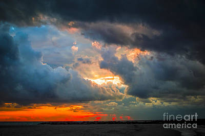 Sun Aura Photograph - Sunset Through Grey Storm Clouds  by Daya Tom