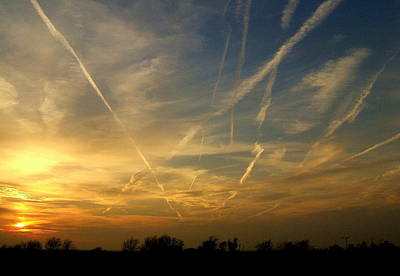 Photograph - Sunset Trails by Claude Oesterreicher