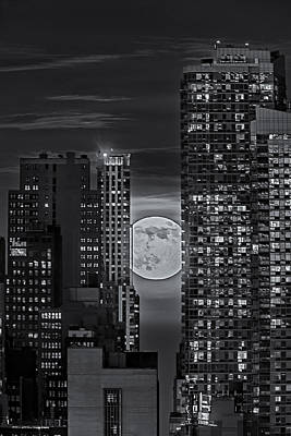 Go For Gold Rights Managed Images - Super Moon Rises Over The Big Apple BW Royalty-Free Image by Susan Candelario