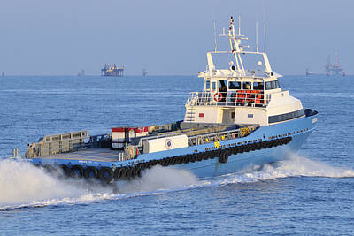 Supply Vessel Heads To Sea Art Print