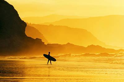 Surfer Entering Water At Misty Sunset Art Print by Mikel Martinez de Osaba