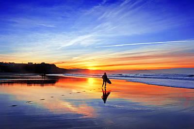 Surfer In Beach At Sunset Art Print by Mikel Martinez de Osaba