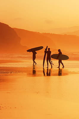 surfers at sunset in Sopelana Print by Mikel Martinez de Osaba