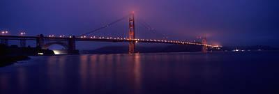 Suspension Bridge Lit Up At Dawn Viewed Art Print by Panoramic Images